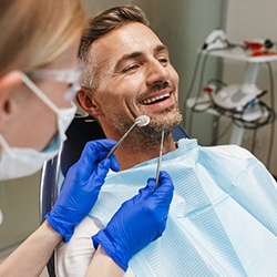 man sitting in the dental chair