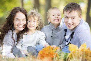 Happy family with beautiful smiles from the family dentist owings mills loves