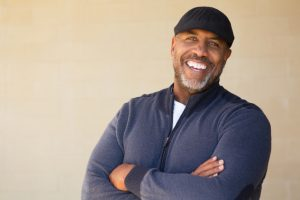 Man with a beautiful smile thanks to dentures in Owings Mills