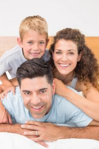 Happy family with beautiful smiles thanks to family dental care in owings mills