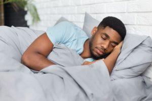 Man sleeping under a weighted blanket