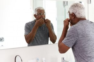 a person flossing their teeth