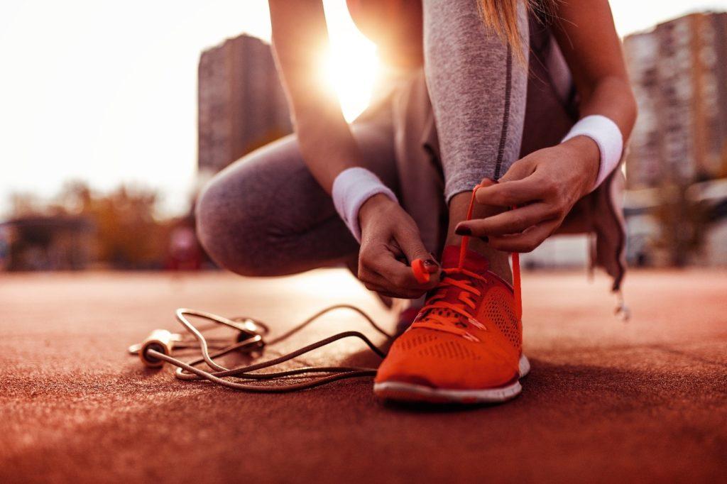 Closeup of woman tying her running shoes